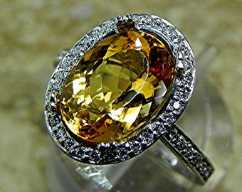 AAAA Natural Untreated Imperial Topaz 3.56 Carat 11 X 8mm. in a 14k White gold Engagement ring with diamonds (.33ct) Ring 1778 H108