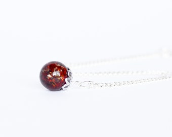 Deep garnet red shattered glass marble necklace on delicate silver chain