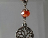 """Orange Ribbon Necklace with Golden Orange Glass Bead and """"Tree Of Life"""" Charm."""