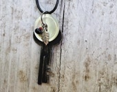 Vintage Safety Deposit Box Key Necklace With White Vintage Button, Black Red Bead and Leaf Charms