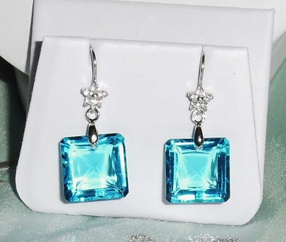 29cts Natural Emerald cut Sea Blue Topaz gemstones, Sterling Silver Pierced Earrings