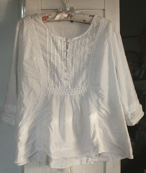 Available In White Long Sleeve Tunic Top Red And Blue Stripes On Sleeves 50% Cotton 50% Polyester Made in USA. 0. Item was added to your bag! View Bag. Checkout. Continue Shopping. My Little White Dress Everyday Dresses Full Of Energy Tunic - White. SHARE. $USD. $10USD.