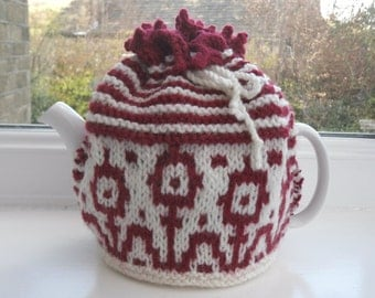 Hand knitted flower tea cosy