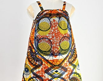 African Print  Girl's  Dress in an orange and yellow abstract pattern