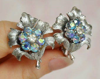 Vintage Clip-On Earrings of Silver Metal Flowers with Rhinestone Centers