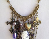 Brass Cameo in Purple with brass findings.