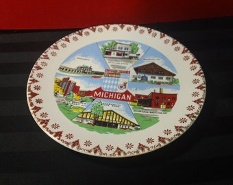 """Vintage Frankenmuth, Michigan decorative Souvenir 7"""" Collector Plate with gold accented edge design"""