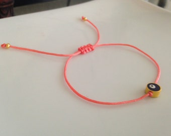 """Evil Eye of Protection Bracelet in """"Salmon Pink"""" Colored String"""