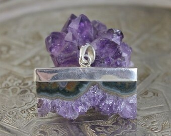 Pendant in silver with and amethyst druzy