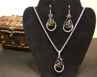 Glass bead wire wrapped earrings and pendent necklace