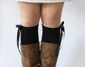 Beinstulpen Jersey schwarz mit Satinschleife