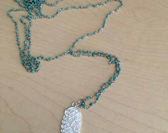 Turquoise wrapped wire necklace with cz angel wing charm