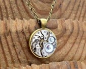Rustic Steampunk Necklace  Pendant  Featuring a Vintage Swiss Watch Movement.
