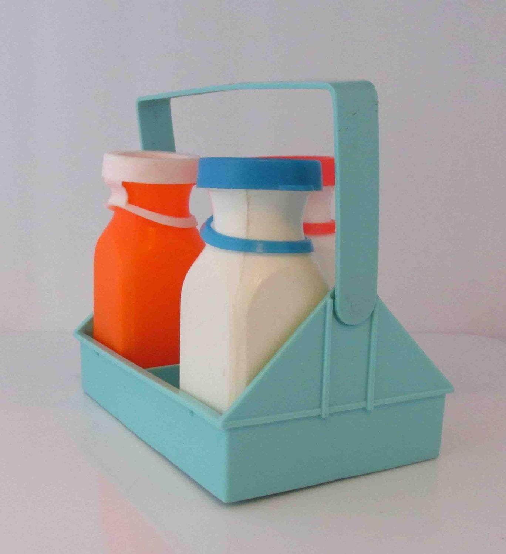reserved fisher price milk bottles and carrier vintage three. Black Bedroom Furniture Sets. Home Design Ideas