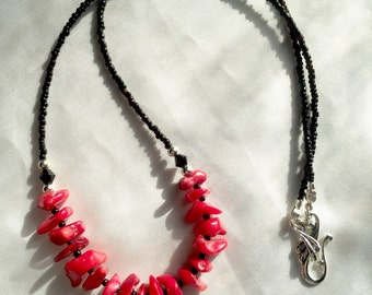Bold red coral & black Swarovski crystal handmade necklace. Boho tribal inspired statement jewelry. Long, layering length. Silver accents.
