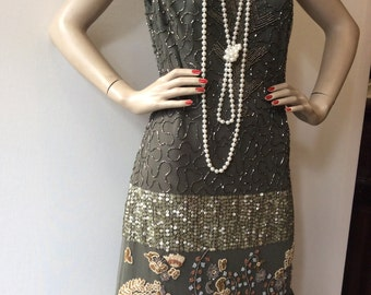 "Dress in 20's Charleston style, green olive and gold all lined, new never worn designed by ""Faust"""