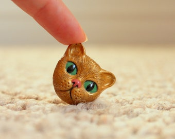 Handmade polymer clay gold cat face cabochon