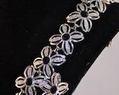 Black Beauty bracelet and clip earrings Sarah Coventry