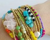 Gift for her - Boho chic Multistrand bracelet - adjustable seedbeed bracelet - tassel bracelet - bohemian style - trendy bracelets - golden