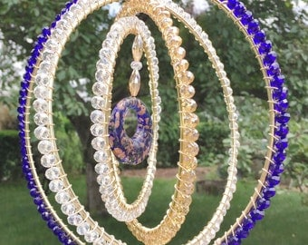 Sun catcher, beaded,unique - Spinning reflections - Midnight Blue. Made with crystal beads and infinity circles.Center Murano glass pendant.