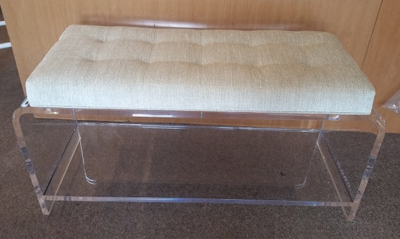 clear acrylic bench with a padded fabric seat and bottom she
