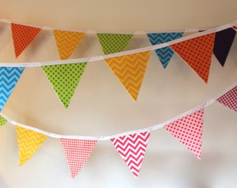 Party decorating, child room. Garland felt pennants, felt. Colorful and festive banner.