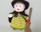 Knitted witch with a broom