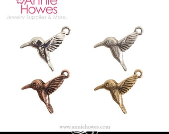 Hummingbird Charm in Shiny Silver, Antique Silver, Antique Gold, or Antique Copper. Sold as single.