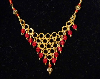 Touch of India chainmaille necklace, red glass beads brass colored jump rings
