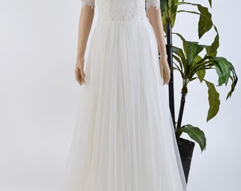 Strapless lace wedding dress with boat neck elbow sleeve lace bolero and tulle skirt