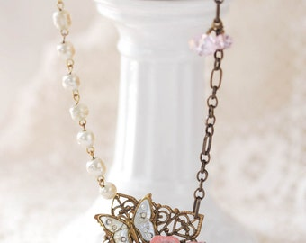 victorian style long pendant necklace with vintage butterfly and metal flowers