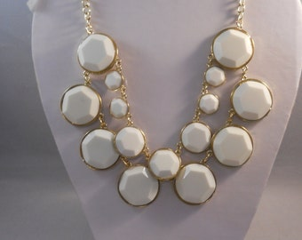 2 Row Bib Necklace with White Beads in Gold Tone Frames on a Gold Tone Chain