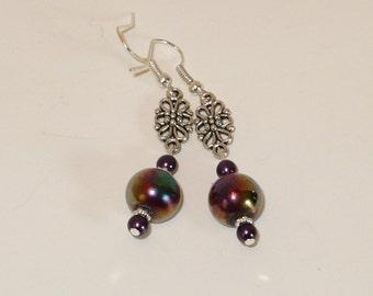 silver filigree and purple firepolished bead dangle earrings.