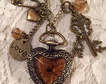 Small Heart Shaped, Pocket Watch Necklace.  The Face Is Amber Glass.