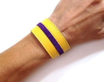 Yellow and purple striped genuine leather bracelet cuff.