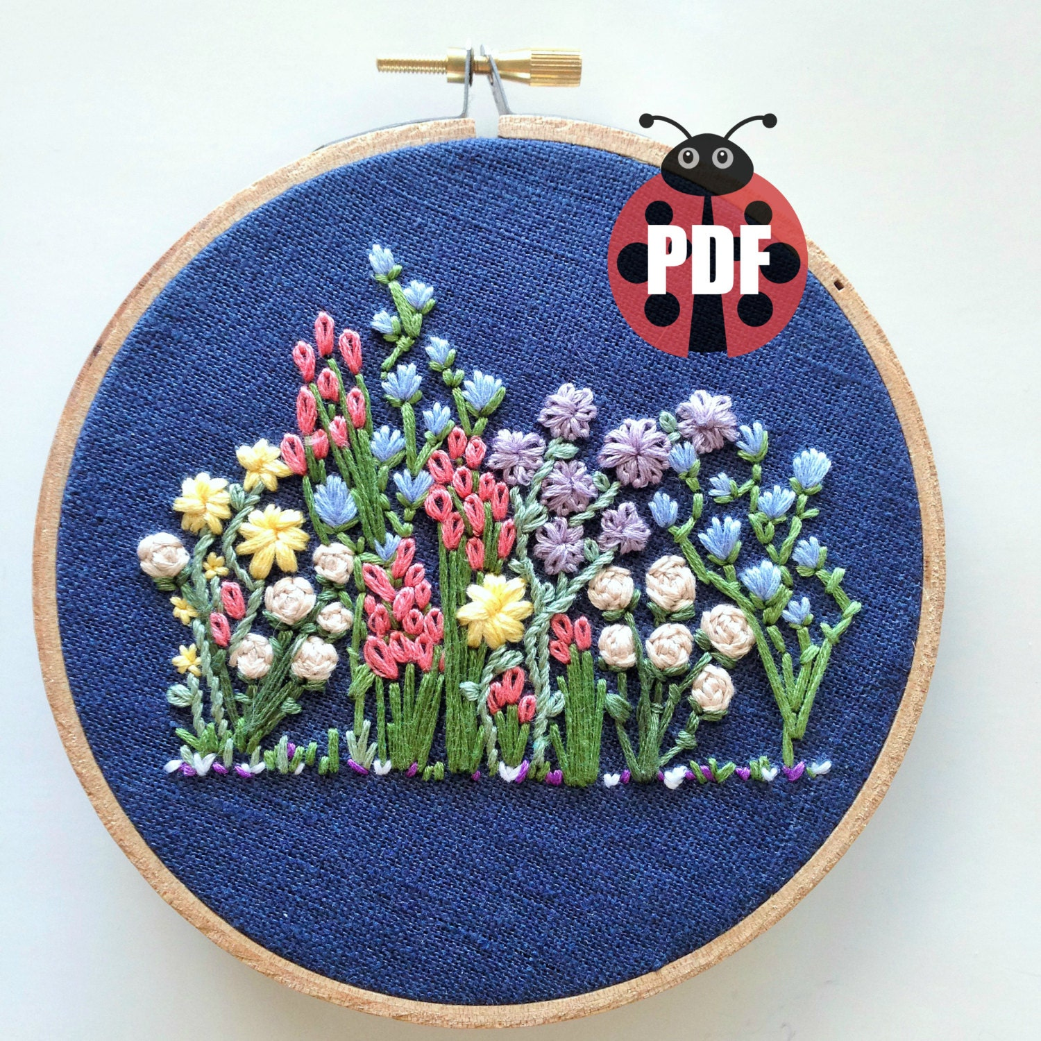 Hand embroidery pattern flower hoop by