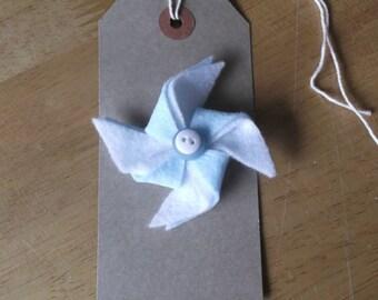 Blue pinwheel style felt brooch