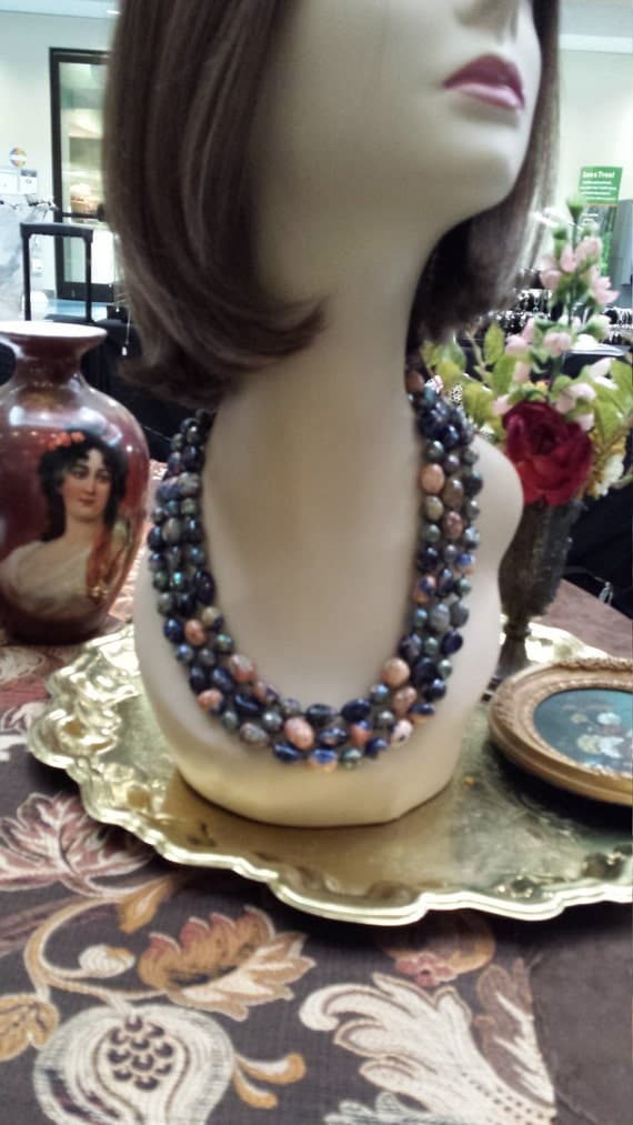 three strand necklace made with exotic blue beads with a mixture of mauve