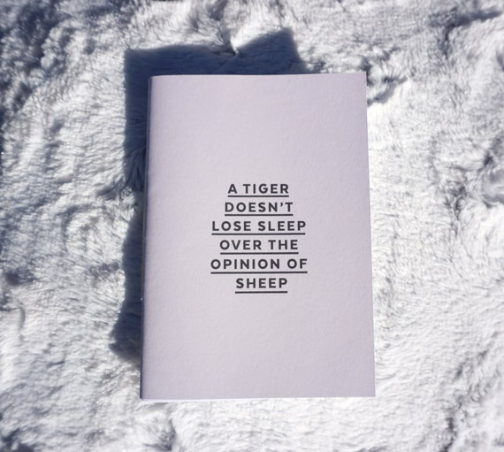 A tiger doesn't lose sleep over the opinion of sheep - Motivational notebooks and journals that will inspire you // The PumpUp Blog