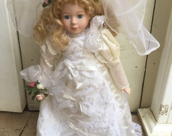 Bride, porcelain doll, blonde, curly hair, blue eyes, gress, good condition