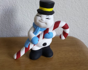 Ceramic Playful Snowman holding Candy Cane (#90B)