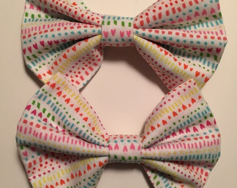 White fabric bow with hearts
