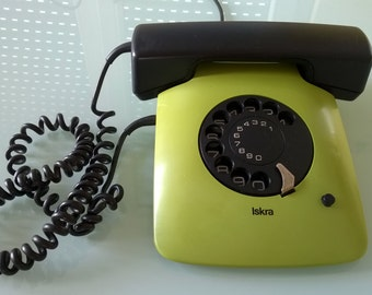 Vintage rotary telephone from Yugoslavia, green ISKRA flat phone