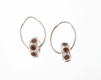Sparkly Picasso earrings in a deep chocolate brown
