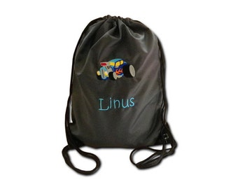 Gym bags with monster truck and name embroidered