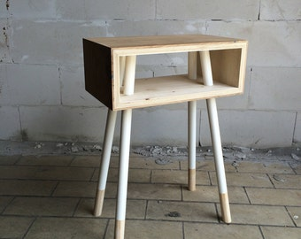 Wooden table with Wooden side table with legs sliced through cool detail