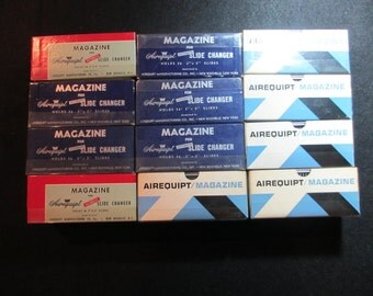 Twelve Airequipt Metal Slide Magazines- Each Holds 36 in Original Box
