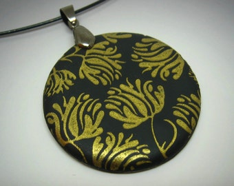 Gold and black silk screen flowers polymer clay pendant