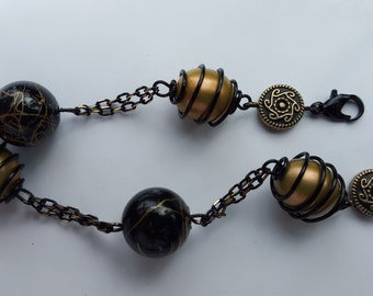 Wire wrapped Black and gold bracelet