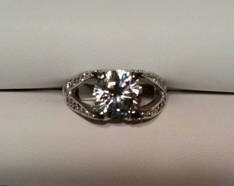 Silvertone ring with large CZ and accents